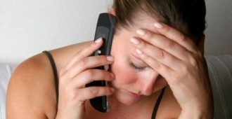 Woman on the Phone Receiving Bad News